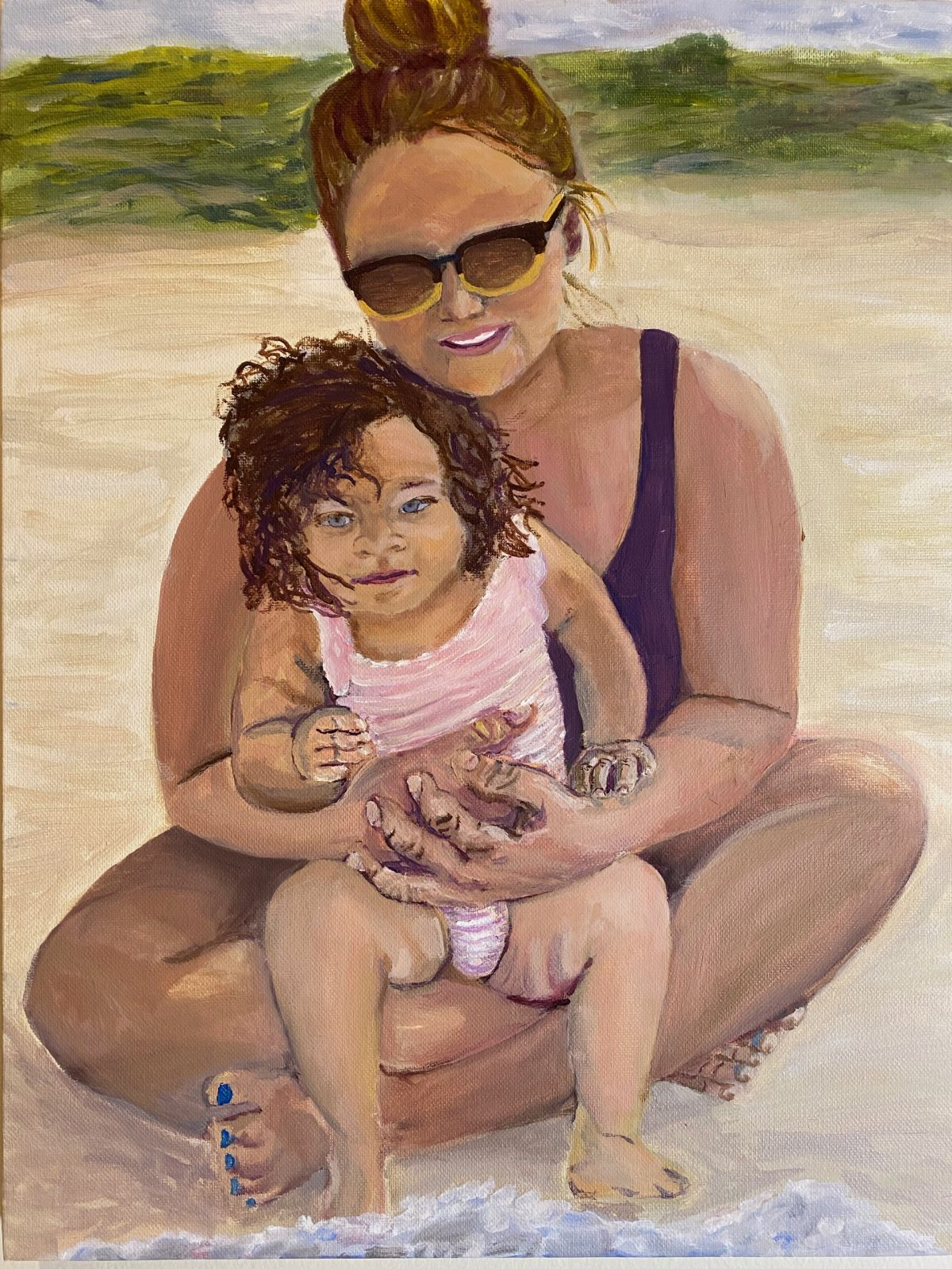 A painting of a woman seated and holding a child in her lap on the beach