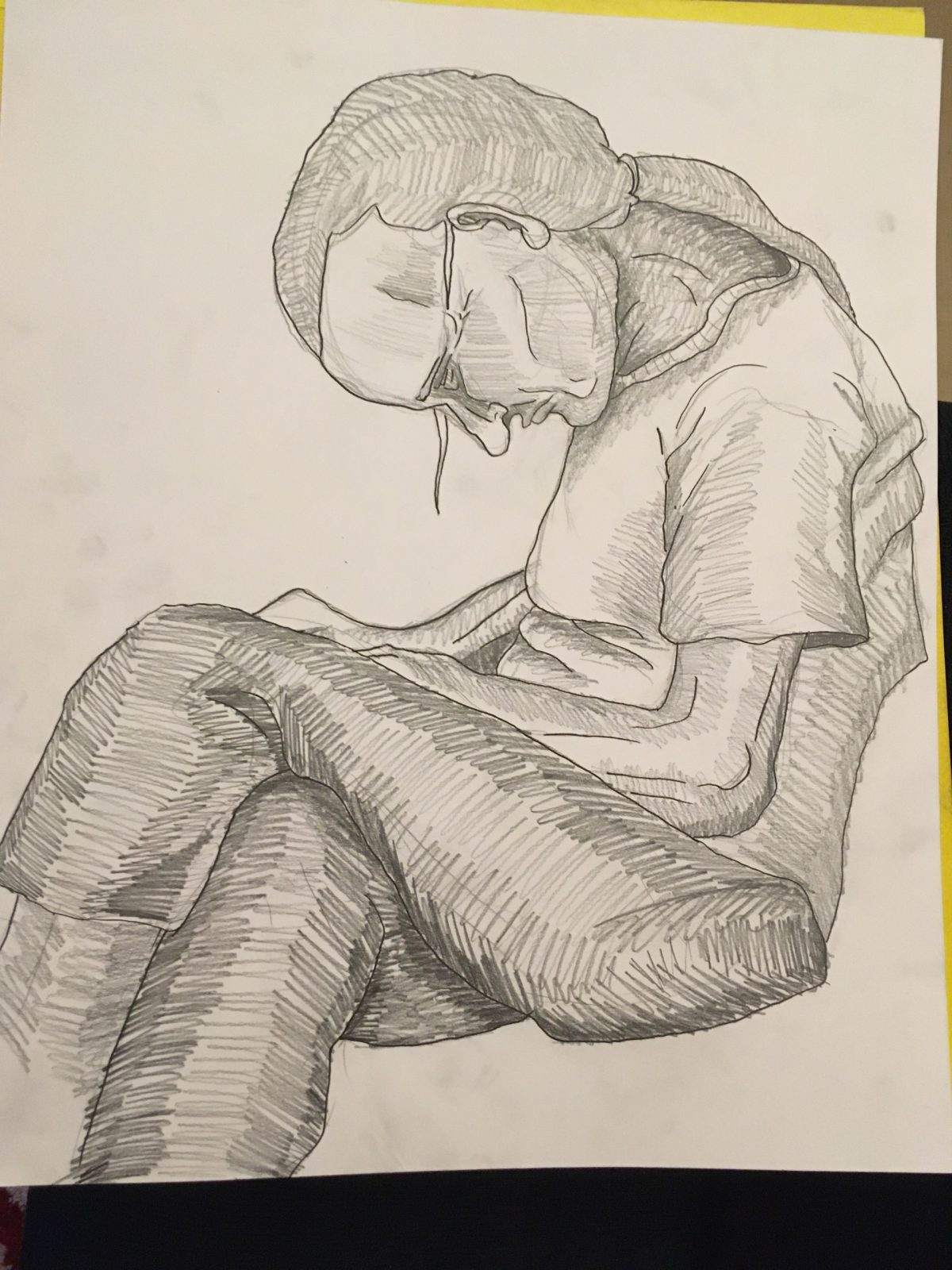 A graphite drawing of an older woman seated with her legs crossed and her head hung low