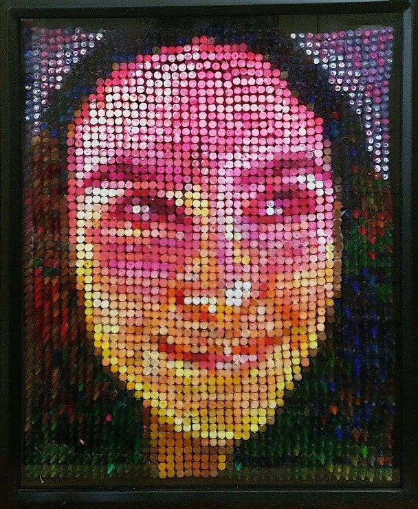A sculptural portrait of the artist made out of crayons