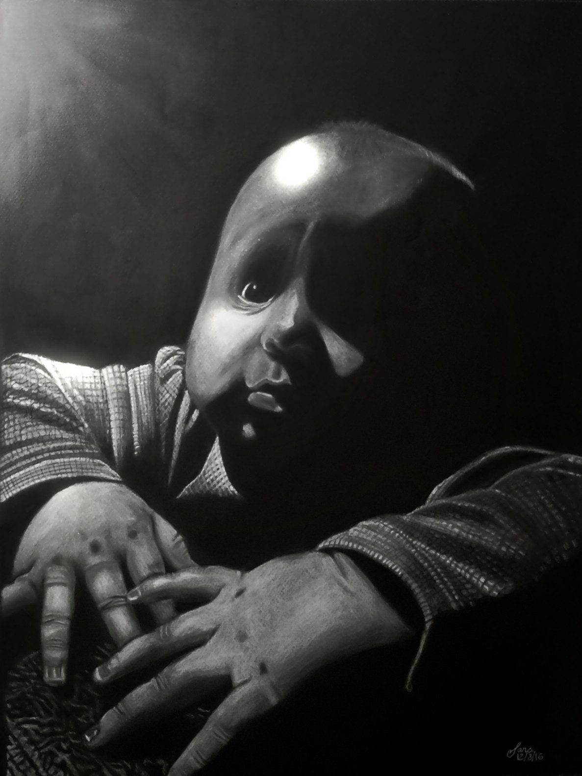A charcoal drawing of a baby